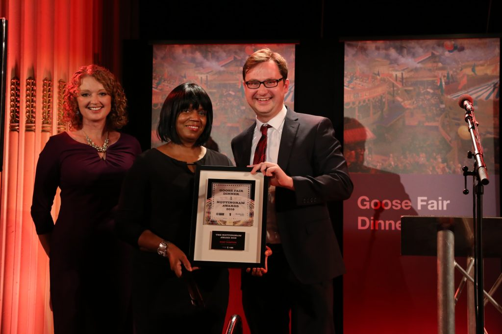 Rose Thompson accepting her award for her contribution in the public sector.